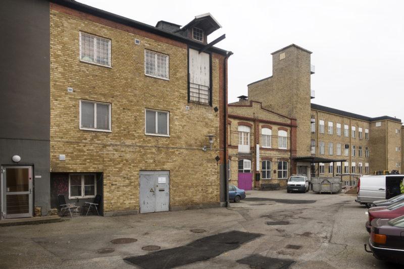 Före detta industribyggnader som innehåller ett antal olika verksamheter, bland andra Skånes Konstförening och Lilith Performance studio, och även byggbolaget MVB.